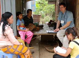 Chris Joseph interviewing a family in Cambodia
